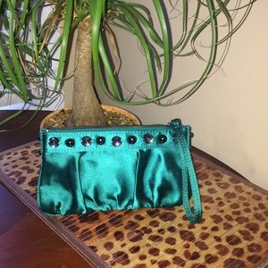 Express green satin clutch with rhinestone detail